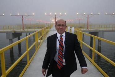Vincent Cardillo, deputy director of aviation operations at Logan, walked on a pier with new runway lights.